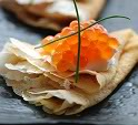 Blini with sour cream and red caviar.jpg